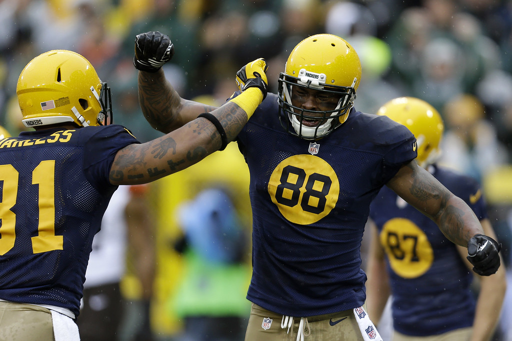 . Jermichael Finley #88 of the Green Bay Packers celebrates with Andrew Quarless #81after scoring a touchdown in the first quarter against the Cleveland Browns during the game at Lambeau Field on October 20, 2013 in Green Bay, Wisconsin. (Photo by Mike McGinnis/Getty Images)