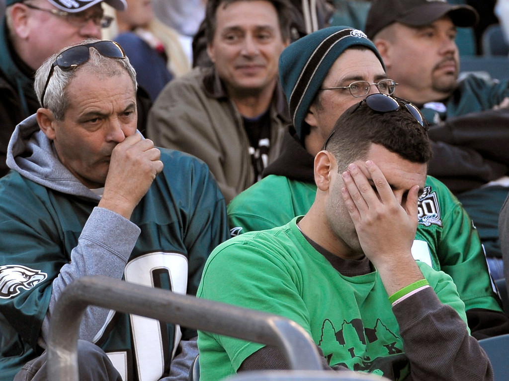 . Philadelphia Eagles fans react during the second half of an NFL football game against the New York Giants, Sunday, Oct. 27, 2013, in Philadelphia. The Giants won the game 15-7. (AP Photo/Michael Perez)