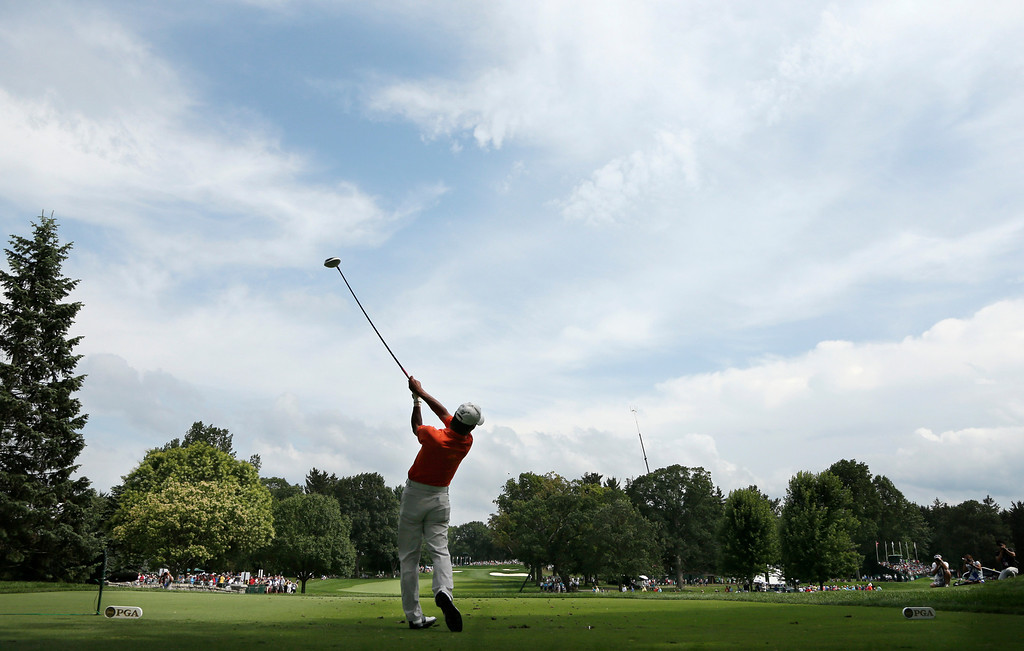 . Kohki Idoki, of Japan, watches his tee shot on the 12th hole during the first round of the PGA Championship golf tournament at Oak Hill Country Club, Thursday, Aug. 8, 2013, in Pittsford, N.Y. (AP Photo/Charlie Riedel)