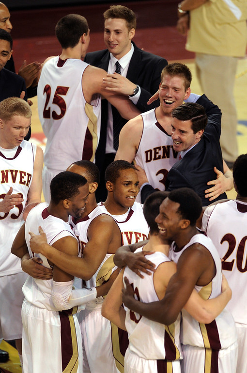 . The Pioneers celebrated the win Saturday night. The University of Denver men\'s basketball team defeated the Louisiana Tech Bulldogs 78-54 at Magness Arena Saturday night, March 9, 2013. (Photo By Karl Gehring/The Denver Post)