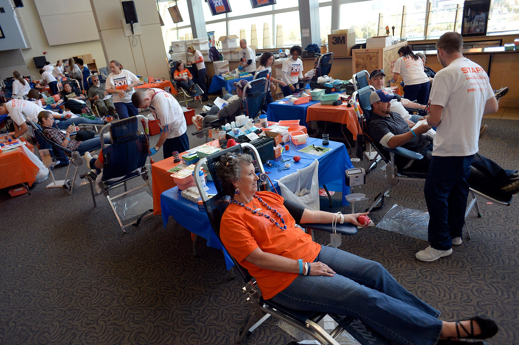 . DENVER, CO - OCTOBER 22: Donors sit in chairs to have their blood drawn during the Denver Broncos and Bonfils Blood Center\'s 16th annual Drive for Life community blood drive October 22, 2013 at Sports Authority Field. (Photo by John Leyba/The Denver Post)