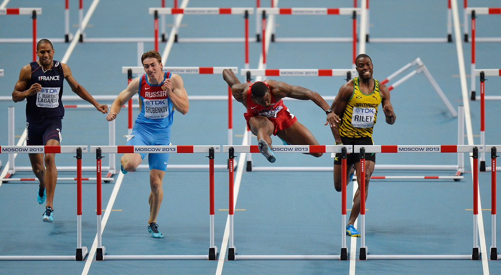 . United States\' David Oliver, second from right, clears a hurdle ahead of Jamaica\'s Andrew Riley, right, Russia\'s Sergey Shubenkov, second from left, and France\'s Thomas Martinot-Lagarde in the men\'s 110-meter hurdles final at the World Athletics Championships in the Luzhniki stadium in Moscow, Russia, Monday, Aug. 12, 2013. (AP Photo/Martin Meissner)