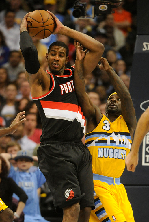 . DENVER, CO. - NOVEMBER 1:  Portland forward LaMarcus Aldridge (12) kept the ball away from Denver\'s Ty Lawon following a rebound in the second half. The Denver Nuggets were defeated by the Portland Trail Blazers 113-98 Friday night, November 1, 2013 at the Pepsi Center.  The Nuggets are winless after two games. Photo By Karl Gehring/The Denver Post