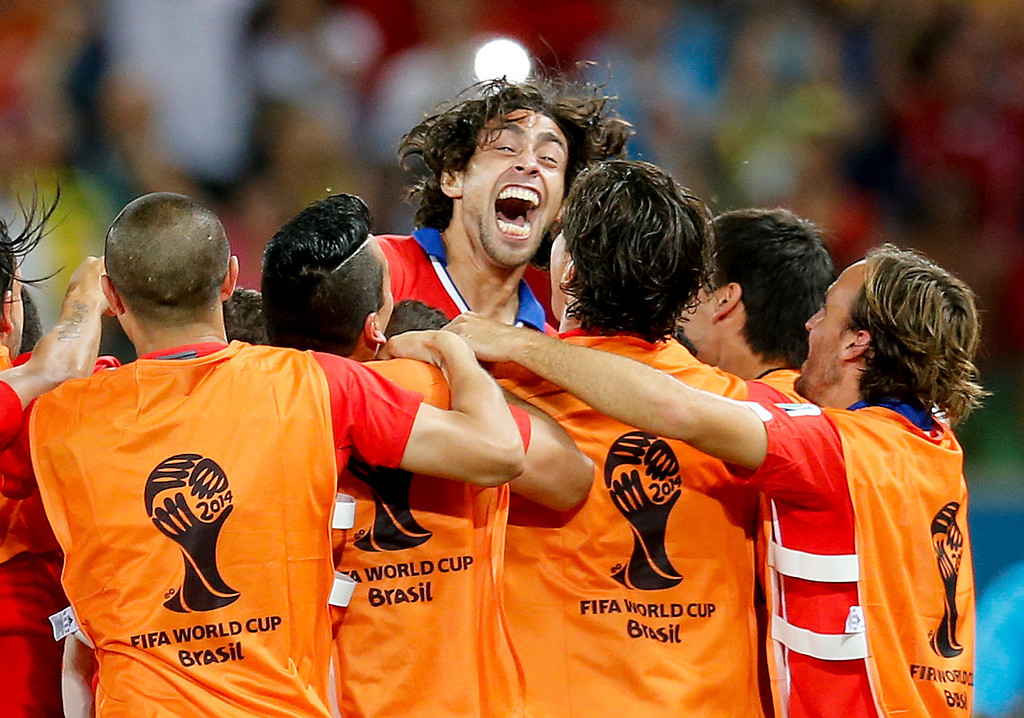 . Chile\'s Jorge Valdivia, top center, celebrates after scoring his side\'s second goal during the group B World Cup soccer match between Chile and Australia in the Arena Pantanal in Cuiaba, Brazil, Friday, June 13, 2014.   (AP Photo/Frank Augstein)