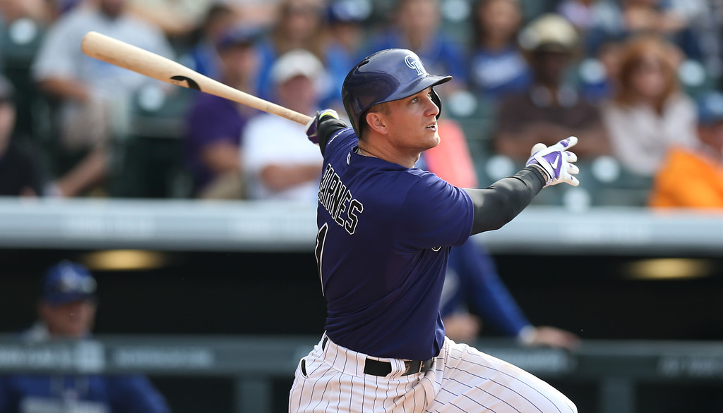 . Colorado Rockies\' Brandon Barnes follows the flight of his RBI-triple to drive in the winning run against the Los Angeles Dodgers in the 10th inning of the Rockies\' 5-4 victory in 10 innings in a baseball game in Denver on Saturday, June 7, 2014. (AP Photo/David Zalubowski)