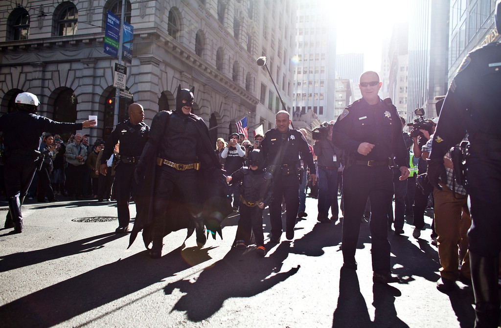 . Police escorts 5-year-old leukemia survivor Miles, also known as BatKid and Batman after they arrest the Riddler November 15, 2013 in San Francisco. Make-A-Wish Greater Bay Area foundation turned the city into Gotham City for Miles by creating a day long event bringing his wish to be a BatKid to life. (Photo by Ramin Talaie/Getty Images)