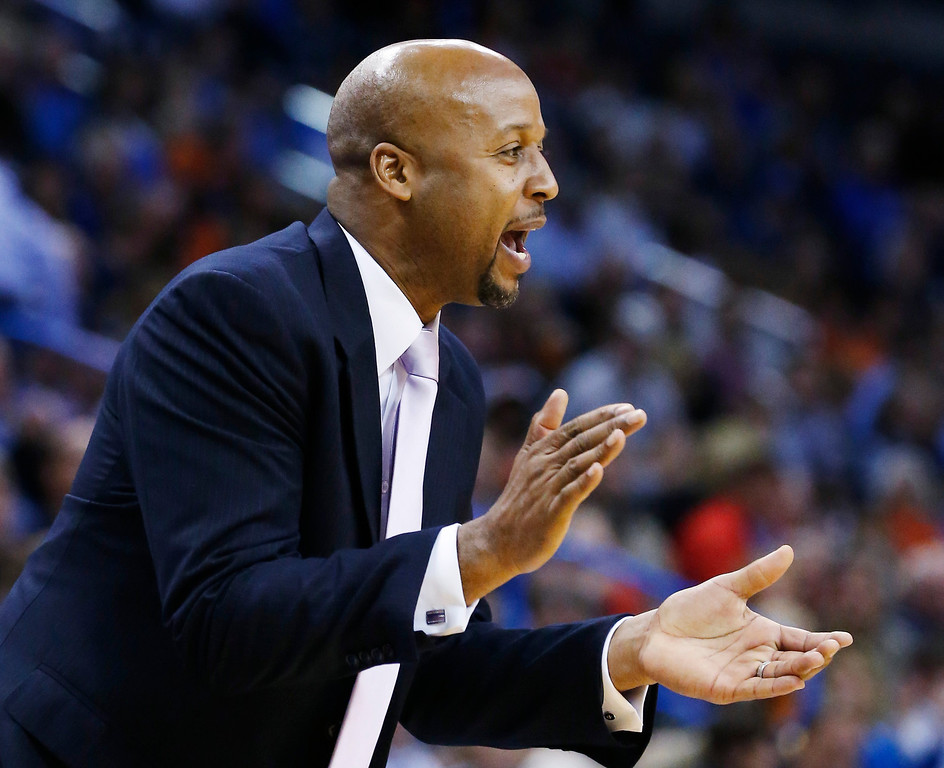 . Denver Nuggets head coach Brian Shaw shouts to his team in the second quarter of an NBA basketball game against the Oklahoma City Thunder in Oklahoma City, Monday, Nov. 18, 2013. (AP Photo/Sue Ogrocki)