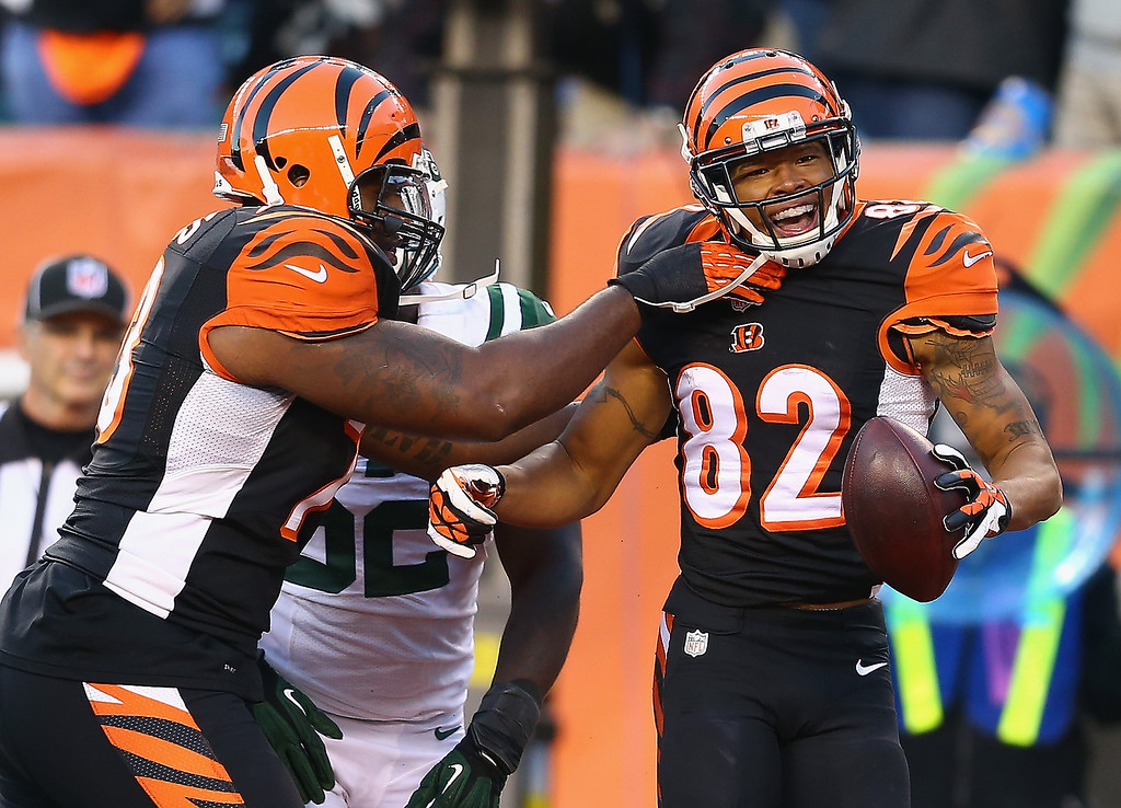 . Marvin Jones #82 of the Cincinnati Bengals celebrates with Anthony Collins #73 (left) after scoring a touchdown during the NFL game against the New York Jets at Paul Brown Stadium on October 27, 2013 in Cincinnati, Ohio.  (Photo by Andy Lyons/Getty Images)