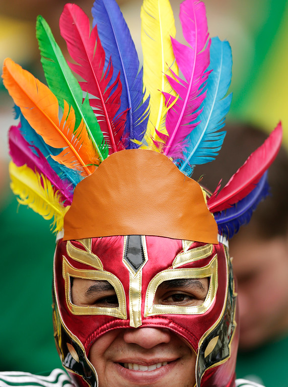 . A Mexican fan wears a wrestling mask before the during the group A World Cup soccer match between Brazil and Mexico at the Arena Castelao in Fortaleza, Brazil, Tuesday, June 17, 2014.  (AP Photo/Marcio Jose Sanchez)