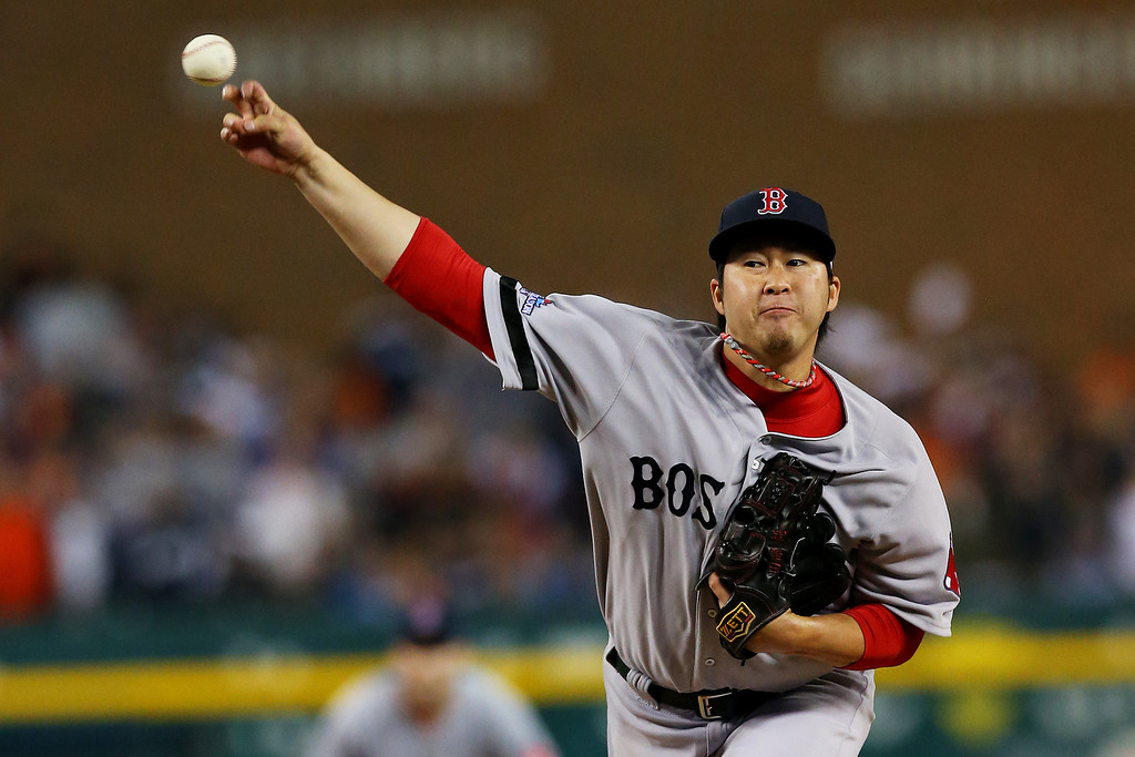 . Junichi Tazawa #36 of the Boston Red Sox pitches against the Detroit Tigers in the eighth inning during Game Three of the American League Championship Series at Comerica Park on October 15, 2013 in Detroit, Michigan.  (Photo by Ronald Martinez/Getty Images)