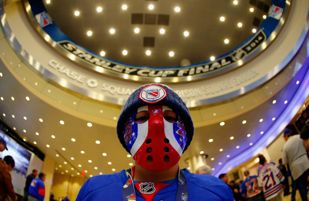 . A New York Rangers fan enters the arena prior to Game Three of the 2014 NHL Stanley Cup Final between the New York Rangers and the Los Angeles Kings at Madison Square Garden on June 9, 2014 in New York, New York.  (Photo by Mike Stobe/Getty Images)
