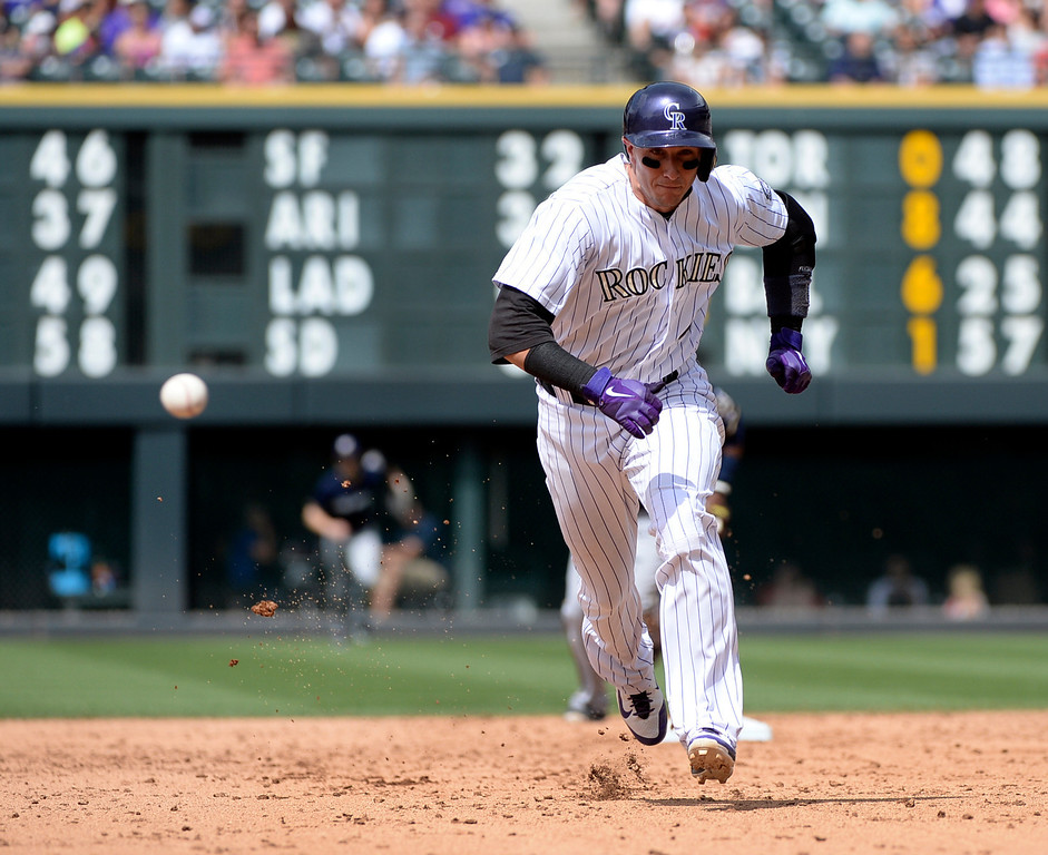 . DENVER, CO - JUNE 20: Colorado baserunner Troy Tulowitzki ran behind a ground ball between second and third base in the third inning. The Colorado Rockies hosted the Milwaukee Brewers at Coors Field Saturday afternoon, June 21, 2014. Photo by Karl Gehring/The Denver Post