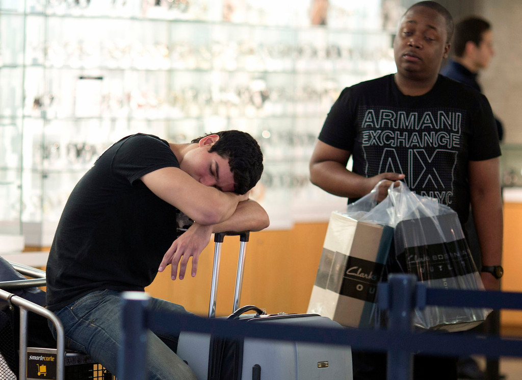 . A shopper relaxes as he makes the rounds in Miami\'s Dolphin Mall, Friday, Nov. 29, 2013. Black Friday, the day after Thanksgiving, is the nation\'s biggest shopping day of the year. (AP Photo/J Pat Carter)