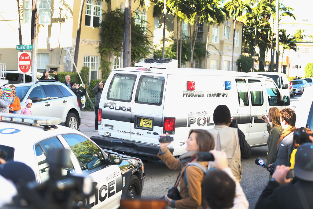 . A Miami Beach Police van carrying Justin Bieber leaves the Miami Beach Police station taking him to jail on January 23, 2014 in Miami Beach, Florida. Justin Bieber was charged with drunken driving, resisting arrest and driving without a valid license after Miami Beach Police found the pop star street racing on Thursday morning.  (Photo by Joe Raedle/Getty Images)