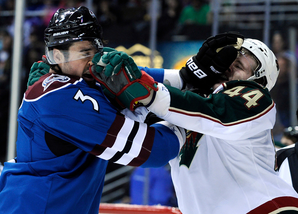 . Colorado Avalanche defenseman Ryan O\'Byrne (3) fights with Minnesota Wild defenseman Justin Falk (44) during the first period of an NHL hockey game on Saturday, March 16, 2013, in Denver. (AP Photo/Jack Dempsey)