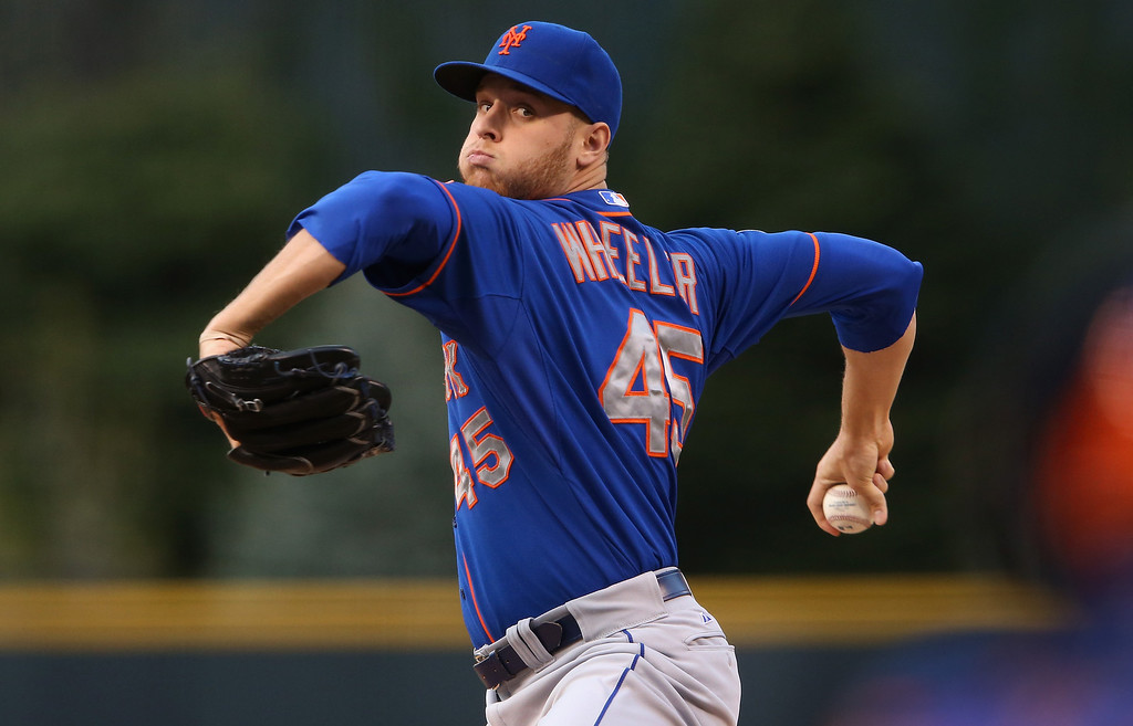 . DENVER, CO - MAY 02:  Starting pitcher Zack Wheeler #45 of the New York Mets delivers against the Colorado Rockies at Coors Field on May 2, 2014 in Denver, Colorado.  (Photo by Doug Pensinger/Getty Images)