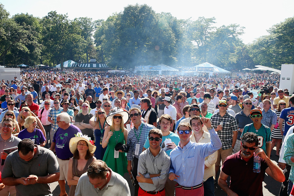 . ELMONT, NY - JUNE 07:  Fans watch a race prior to the Belmont Stakes at Belmont Park on June 7, 2014 in Elmont, New York.  (Photo by Streeter Lecka/Getty Images)