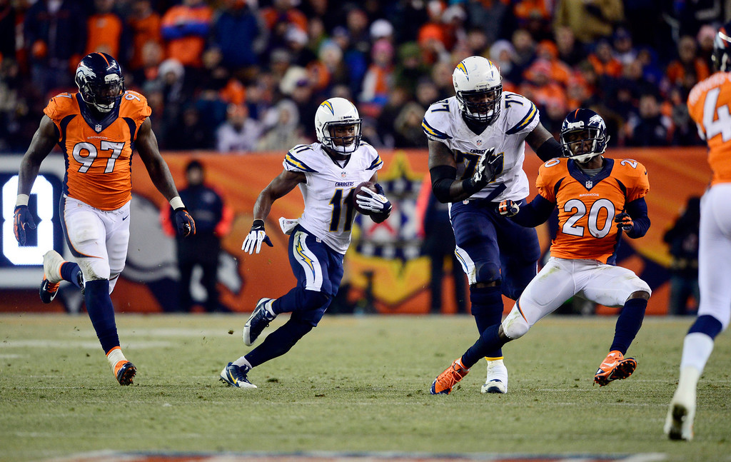 . San Diego Chargers wide receiver Eddie Royal (11) gains 20 yards in the second half.  The Denver Broncos vs. the San Diego Chargers at Sports Authority Field at Mile High in Denver on December 12, 2013. (Photo by AAron Ontiveroz/The Denver Post)