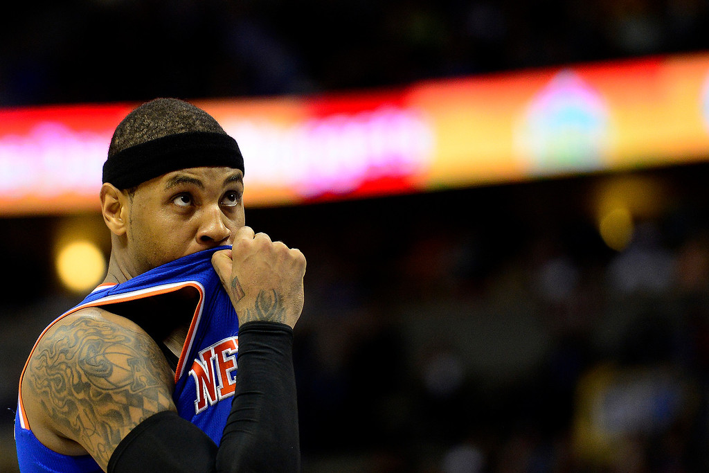 . DENVER, CO - MARCH 13: Carmelo Anthony (7) of the New York Knicks wipes his face during the first half of action. The Denver Nuggets play the New York Knicks at the Pepsi Center. (Photo by AAron Ontiveroz/The Denver Post)