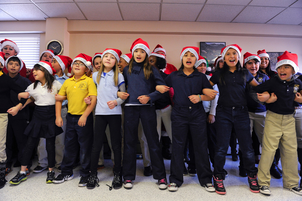 . Students and parents from the Denver Center for International Studies at Ford Elementary School spend a Saturday singing holiday songs in three different languages to the residents of the Kindred Care nursing home.  (Photo by Kathryn Scott Osler/The Denver Post)