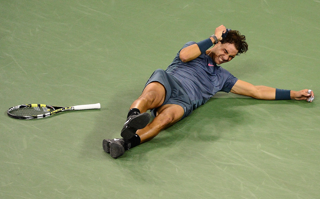 . Spanish tennis player Rafael Nadal reacts after defeating Serbia\'s Novak Djokovic during the 2013 US Open men\'s final at the USTA Billie Jean King National Tennis Center in New York on September 9, 2013.    EMMANUEL DUNAND/AFP/Getty Images