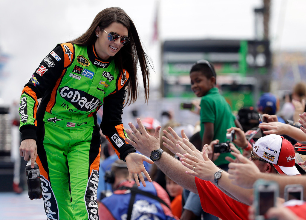 . Driver Danica Patrick is introduced before the NASCAR Daytona 500 Sprint Cup series auto race at Daytona International Speedway in Daytona Beach, Fla., Sunday, Feb. 23, 2014. (AP Photo/John Raoux)