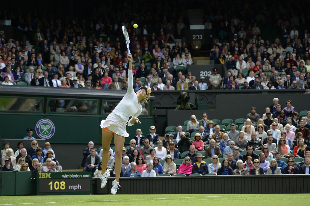 . Russia\'s Maria Sharapova serves against France\'s Kristina Mladenovic during their women\'s first round match on day one of the 2013 Wimbledon Championships tennis tournament at the All England Club in Wimbledon, southwest London, on June 24, 2013.  ADRIAN DENNIS/AFP/Getty Images