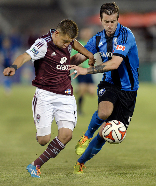 . Colorado midfielder Dillon Serna (17) tried to get past Montreal defender Jeb Brovsky (5) in the second half. The Colorado Rapids defeated the Montreal Impact 4-1 Saturday night, May 24, 2014. (Photo by Karl Gehring/The Denver Post)