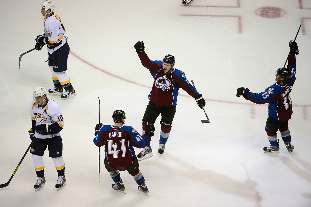 . Jamie McGinn (11) of the Colorado Avalanche celebrates his goal with Tyson Barrie (41) against the Nashville Predators during the second period of action. The Colorado Avalanche take on the Nashville Predators at the Pepsi Center on February 18, 2013. (Photo By AAron Ontiveroz/The Denver Post)