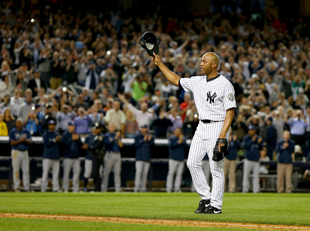 . NEW YORK, NY - SEPTEMBER 26:  Mariano Rivera #42 of the New York Yankees salutes the fans after he is pulled from the game in the ninth inning against the Tampa Bay Rays on September 26, 2013 at Yankee Stadium in the Bronx borough of New York City.  (Photo by Elsa/Getty Images)