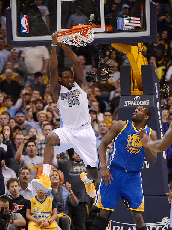 . Denver Nuggets small forward Kenneth Faried (35) dunks the ball over Golden State Warriors center Festus Ezeli (31) in the fourth quarter. The Denver Nuggets took on the Golden State Warriors in Game 5 of the Western Conference First Round Series at the Pepsi Center in Denver, Colo. on April 30, 2013. (Photo by John Leyba/The Denver Post)
