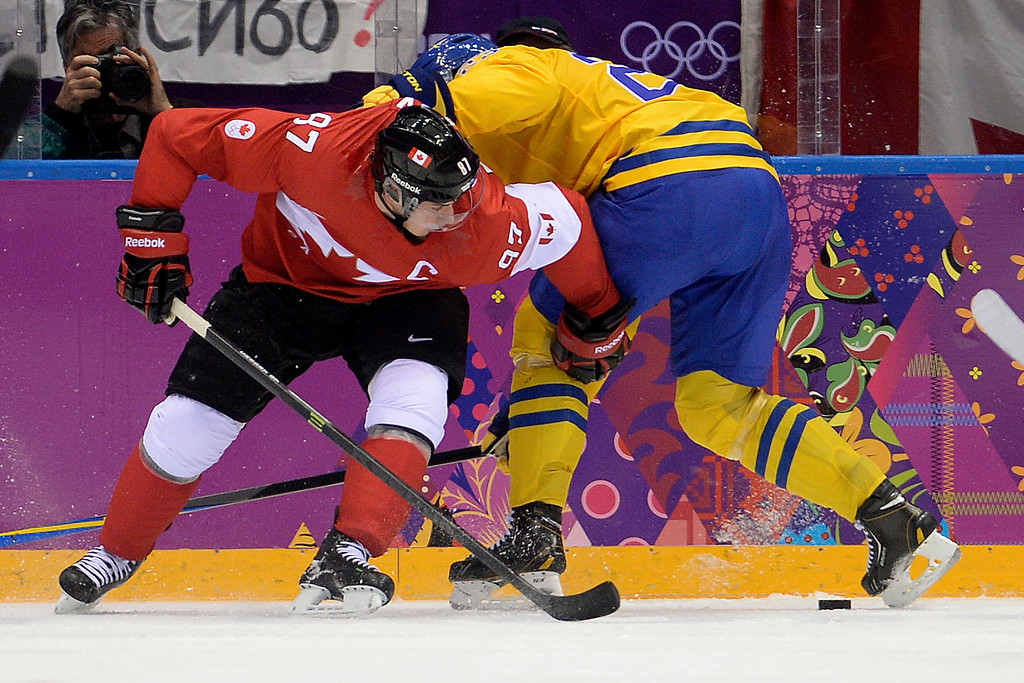 . Sidney Crosby (87) of Canada and Alexander Edler (23) of Sweden tangle during the second period of the men\'s ice hockey gold medal game. Sochi 2014 Winter Olympics on Sunday, February 23, 2014 at Bolshoy Ice Arena. (Photo by AAron Ontiveroz/ The Denver Post)