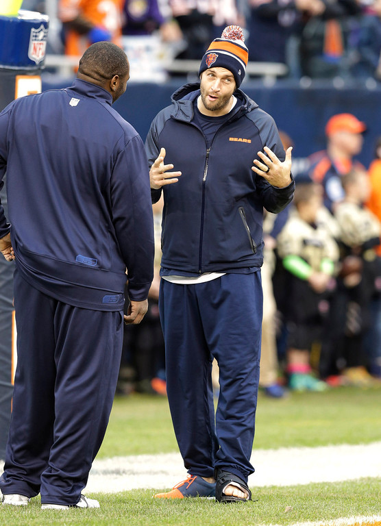 . Injured Chicago Bears quarterback Jay Cutler, right, talks with a teammate before an NFL football game against the Baltimore Ravens, Sunday, Nov. 17, 2013, in Chicago. (AP Photo/Nam Y. Huh)