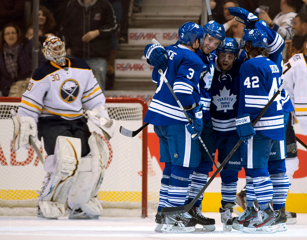 . Buffalo Sabres goaltender Ryan Miller (30) watches as Toronto Maple Leafs\' Dion Phaneuf (3), Cody Franson (4), Phil Kessel (81) and Tyler Bozak (42) celebrate James van Riemsdyk\'s, rear right, goal during the third period of their NHL hockey game, Thursday, Feb. 21, 2013, in Toronto. (AP Photo/The Canadian Press, Frank Gunn)