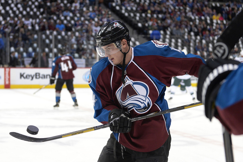. Colorado defenseman Tyson Barrie juggled a puck on the blade of his stick before the game Saturday. The Colorado Avalanche hosted the Minnesota Wild at the Pepsi Center Saturday night, April 19, 2014 in an NHL playoff game. (Photo by Karl Gehring/The Denver Post)