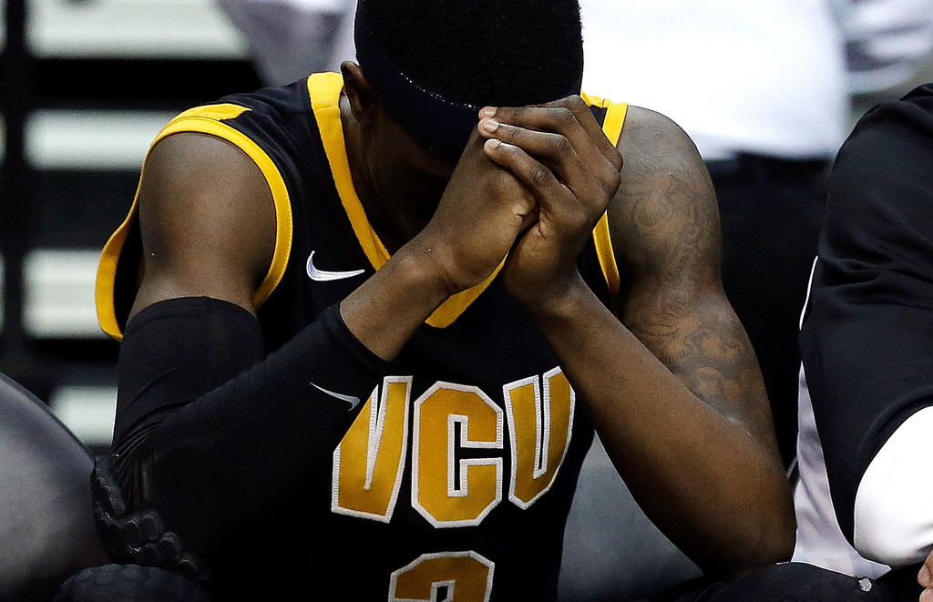 . Virginia Commonwealth guard Briante Weber (2) sits on the bench against Michigan in the second half of their third-round game of the NCAA college basketball tournament in Auburn Hills, Mich., Saturday March 23, 2013. Michigan won 78-53. (AP Photo/Paul Sancya)