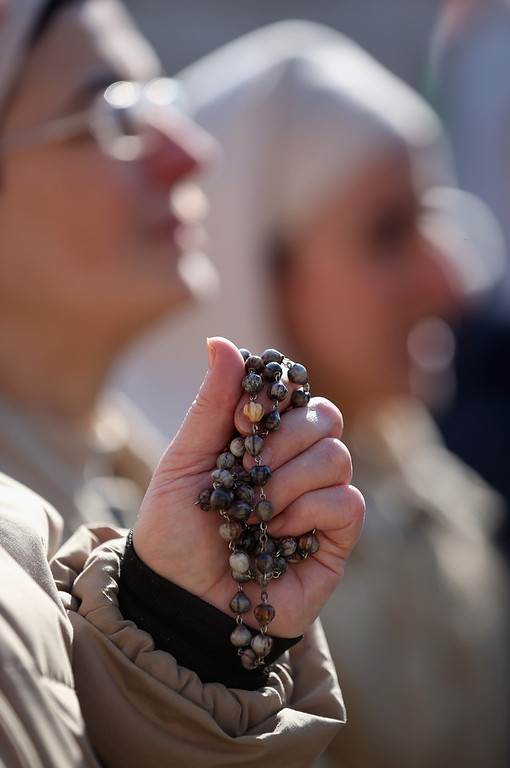 . A nun holds her rosary beads as she attends Pope Benedict XVI\'s final general audience in St Peter\'s Square before his retirement on February 27, 2013 in Vatican City, Vatican. The Pontiff has held his last weekly public audience before stepping down tomorrow. Pope Benedict XVI has been the leader of the Catholic Church for eight years and is the first Pope to retire since 1415. He cites ailing health as his reason for retirement and will spend the rest of his life in solitude away from public engagements.  (Photo by Christopher Furlong/Getty Images)