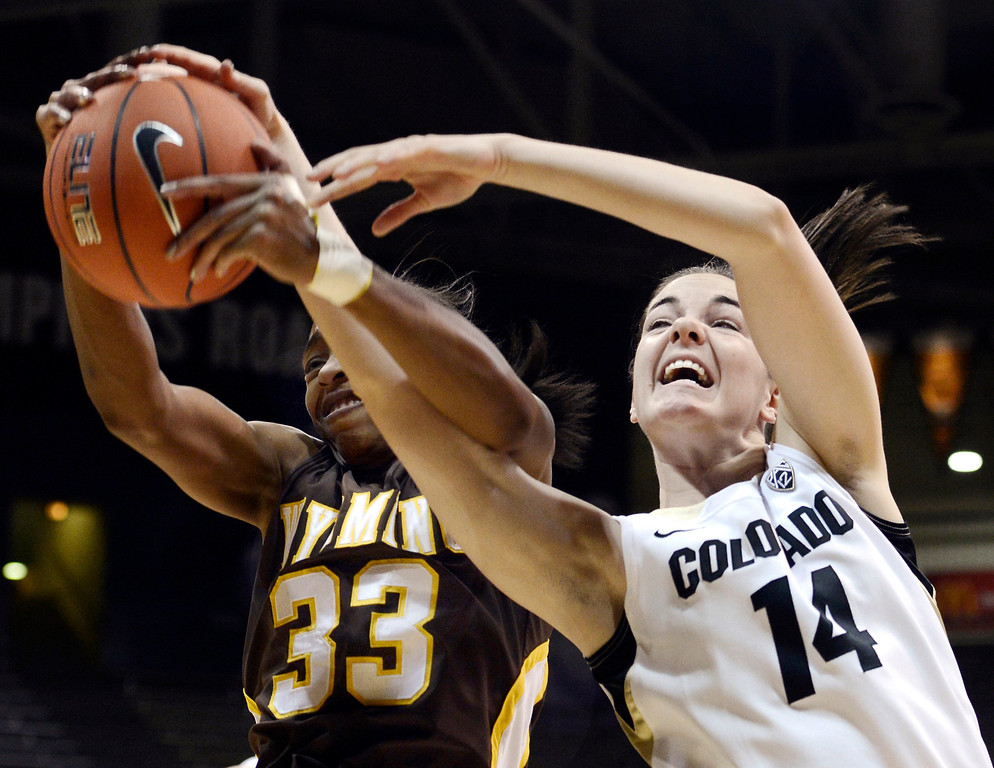 . Colorado\'s Meagan Malcolm-Peck (14) fights for a rebound with Wyoming\'s Chaundra Sewell (33) during their NCAA college basketball game, Wednesday, Nov. 28, 2012, in Boulder, Colo. (AP Photo/The Daily Camera, Jeremy Papasso)