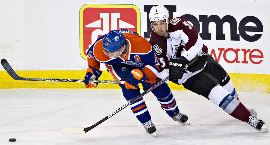 . Colorado Avalanche\'s Shane O\'Brien and Edmonton Oilers\' Jordan Eberle battle for the puck during the first period of their NHL hockey game, Monday, Jan. 28, 2013, in Edmonton, Alberta. (AP Photo/The Canadian Press, Jason Franson)