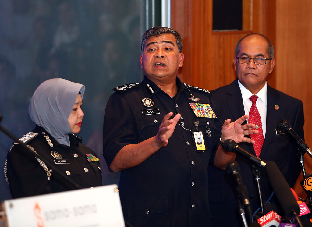 . Tan Sri Khalid Ibrahim, Inspector General Police of Malaysia (centre) briefs the media on the progress of their investigations on March 11, 2014 in Kuala Lumpur, Malaysia. Officials have expanded the searh area for missing Malaysia Airlines flight MH370 to include more of the Gulf of Thailand between Malayisa and Vietnam and land along the Malay Peninsula. The flight carrying 239 passengers  from Kuala Lumpur to Thailand was reported missing on the morning of March 8 after the crew failed to check in as scheduled. Relatives of the missing passengers have been advised to prepare for the worst as authorities focus on two passengers on board traveling with stolen passports.  (Photo by How Foo Yeen/Getty Images)