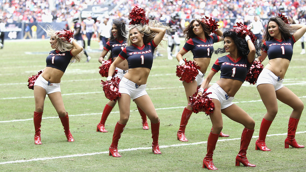. Houston Texans cheerleaders perform during the game against the New England Patriots at Reliant Stadium on December 1, 2013 in Houston, Texas.  (Photo by Bob Levey/Getty Images)