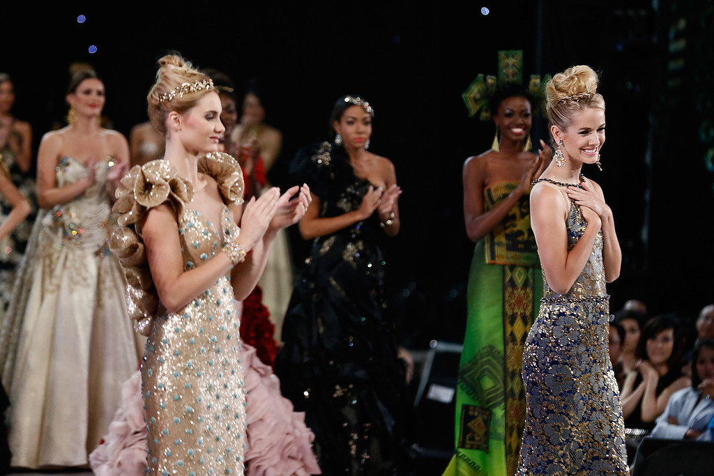 . Miss World 2013 Olivia Jordan of the United States of America (R) poses during top model show on September 24, 2013 in Nusa Dua, Indonesia. Indonesia\'s government has moved the final round of the Miss World pageant from Jakarta to the resort island of Bali due to the ongoing Muslim protests.  (Photo by Putu Sayoga/Getty Images)