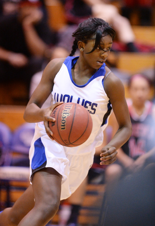 . AURORA, CO. JANUARY 08: Michaela Onyenwere of Grandview High School (12) controls the ball during the game against Eaglecrest High School at Grandview High School in Aurora, Colorado January 8, 2014. Grandview won 69-22. (Photo by Hyoung Chang/The Denver Post)
