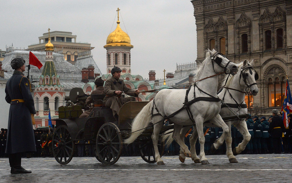 . Wearing World War II-era uniform of the Red Army troops Russian soldiers ride in tachanka, a horse-drawn machine gun wagon, during in a military parade at the Red Square in Moscow, on November 7, 2013. This week Russia marks the 72nd anniversary of the November 7, 1941, parade, when Red Army troops marched past the Kremlin and then went directly to the front line to fight the Nazi Germany troops at the gates of the Russian capital. VASILY MAXIMOV/AFP/Getty Images