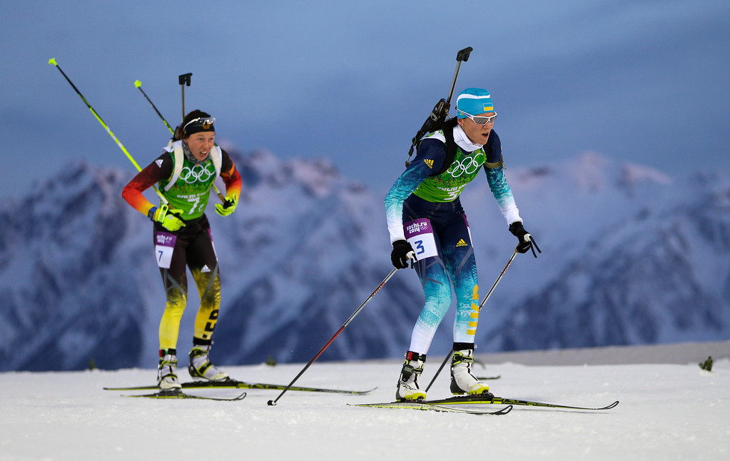 . Germany\'s Laura Dahlmeier, left, and Ukraine\'s Mariya Panfilova ski during the mixed biathlon relay at the 2014 Winter Olympics, Wednesday, Feb. 19, 2014, in Krasnaya Polyana, Russia. (AP Photo/Felipe Dana)