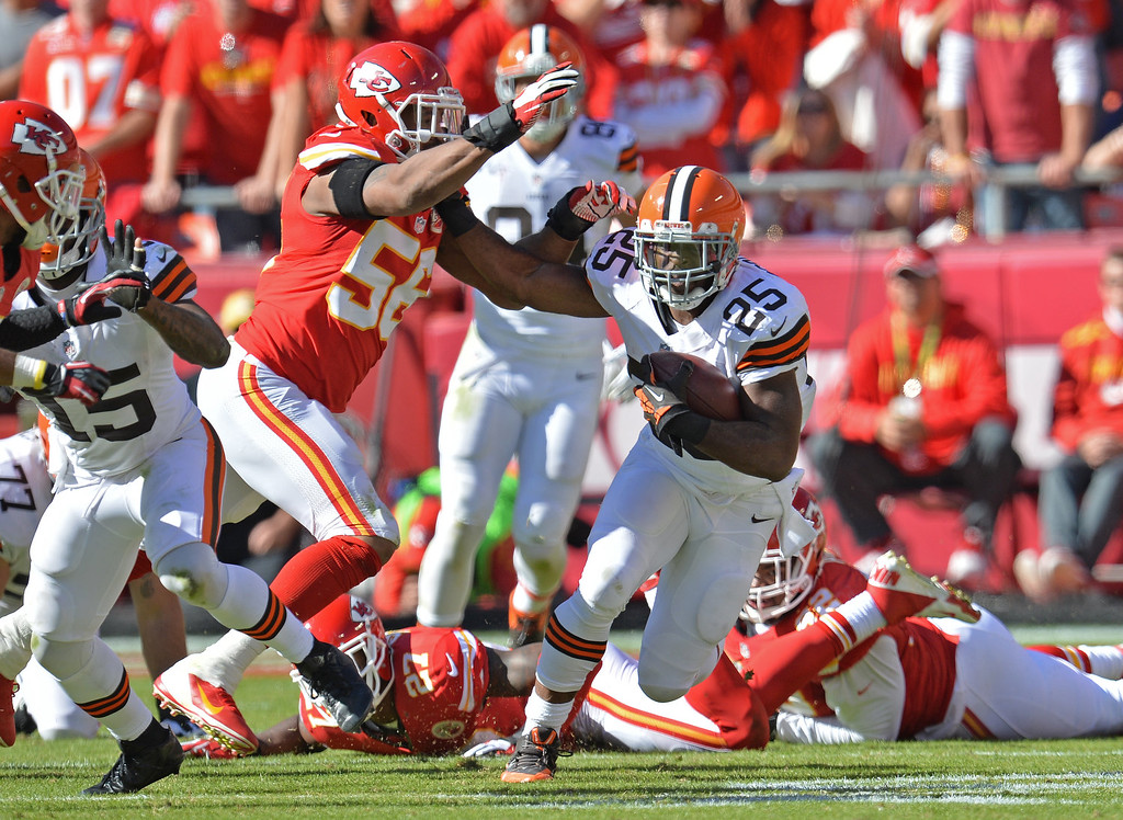 . Running back Chris Ogbonnaya #25 of the Cleveland Browns rushes against pressure from linebacker Derrick Johnson #56 of the Kansas City Chiefs during the second half on October 27, 2013 at Arrowhead Stadium in Kansas City, Missouri. Kansas City won 23-17. (Photo by Peter Aiken/Getty Images)