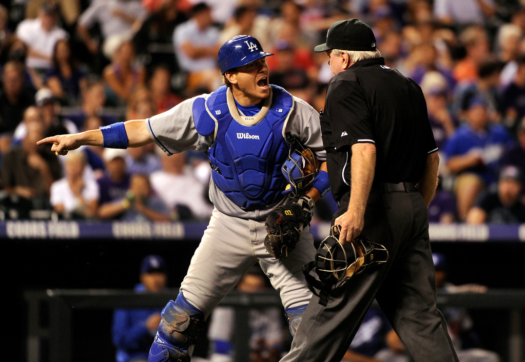 . DENVER, CO. - SEPTEMBER 4: Dodgers catcher A.J.Ellis complained after umpire Brian Gorman reversed a call to give Rockers batter DJ LeMahhieu another strike at the plate in the sixth inning. The Colorado Rockies hosted the Los Angeles Dodgers at Coors Field Wednesday night, September 4, 2013.  Photo By Karl Gehring/The Denver Post
