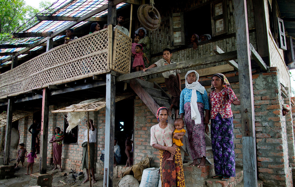 . Internally displaced Rohingya take refuge in a building belonging to a mosque in Sittwe, northwestern Rakhine State, Myanmar, ahead of the arrival of Cyclone Mahasen, Wednesday, May 15, 2013. A massive evacuation to clear low-lying camps ahead of the cyclone has run into a potentially deadly snag as members of the displaced Rohingya minority living there have refused to leave because they don\'t trust Myanmar authorities. (AP Photo/Gemunu Amarasinghe)