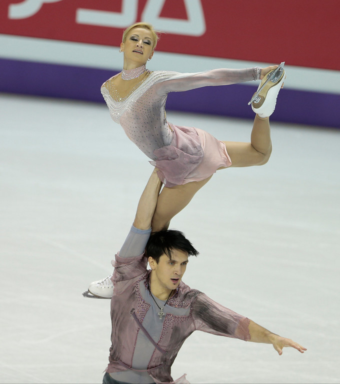 . Tatiana Volosozhar and Maxim Trankov of Russia compete for Russia during the Pairs Free Skating event at the 2013 World Figure Skating Championships March 15, 2013 in London, Ontario, Canada. Skaters from around the globe are competing in the four day event to become the world champions in mens, ladies, pairs and ice dance figure skating.  AFP PHOTO/GEOFF ROBINS/AFP/Getty Images