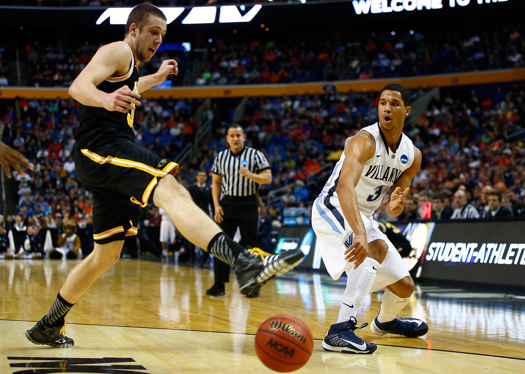 . BUFFALO, NY - MARCH 20: Josh Hart #3 of the Villanova Wildcats passes the ball as Austin Arians #34 of the Milwaukee Panthers defends during the second round of the 2014 NCAA Men\'s Basketball Tournament at the First Niagara Center on March 20, 2014 in Buffalo, New York.  (Photo by Jared Wickerham/Getty Images)
